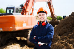 Man at work in a construction site Royalty Free Stock Images
