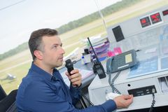 Man at work in control tower. Communication stock images