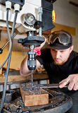 Man in work on electric drill press Stock Photography