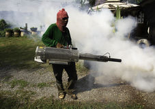 Man work fogging to eliminate mosquito for preventing spread den stock photography