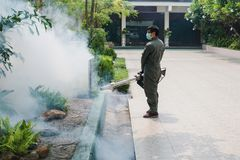 Man work fogging to eliminate mosquito for preventing spread dengue fever and zika virus stock images