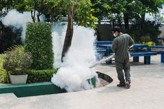 Man work fogging to eliminate mosquito for preventing spread dengue fever and zika virus stock photos