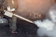 Man work fogging to eliminate mosquito and zika virus. Man work fogging to eliminate mosquito for preventing spread dengue fever and zika virus stock photos