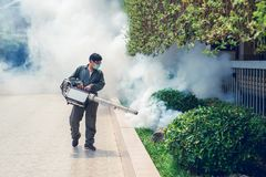 Man work fogging to eliminate mosquito and zika virus. Man work fogging to eliminate mosquito for preventing spread dengue fever and zika virus stock photography