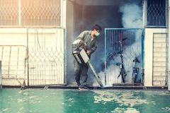 Man work fogging to eliminate mosquito and zika virus. Man work fogging to eliminate mosquito for preventing spread dengue fever and zika virus stock image