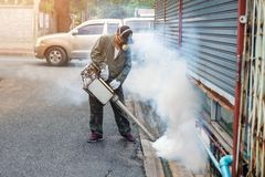 Man work fogging to eliminate mosquito and zika virus stock images