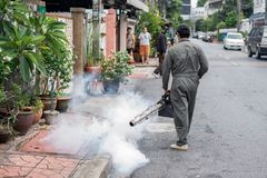 Man work fogging to eliminate mosquito and zika virus royalty free stock photography