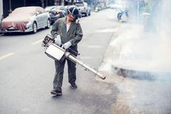Man work fogging to eliminate mosquito and zika virus. Man work fogging to eliminate mosquito for preventing spread dengue fever and zika virus stock photo