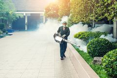 Man work fogging to eliminate mosquito and zika virus. Man work fogging to eliminate mosquito for preventing spread dengue fever and zika virus royalty free stock photos