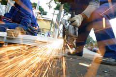 Man at work grinding steel Royalty Free Stock Images