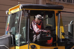 Man at work, industrial steam roller driver in cabin Royalty Free Stock Photography