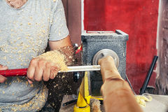 Man work on the lathe wood Royalty Free Stock Photos