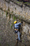 Man at work, Luxembourg. The old fortess walls of Luxembourg require periodic maintenance and this means a worker has to abseil down the side to maintain the Royalty Free Stock Photos