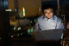 Man work at night Stock Images