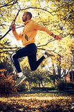 Man work out in nature. Young sporty man exercise in park Stock Image