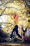 Man work out in nature. On the move. Man work out in nature. Young sporty man exercise in park Stock Photography