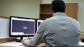 Man work on PC inthe office. Man work on PC , at office stock footage