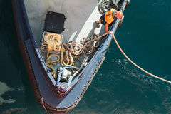 Man at work with ropes on a bow of small tugboat Royalty Free Stock Photo