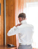 Man with work shirt and tie in morning bedroom home Royalty Free Stock Photos