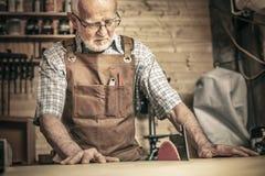 Man work at tablesaw royalty free stock image