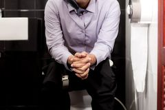 Man of work in toilet. Young man of work outfit in the toilet Royalty Free Stock Images