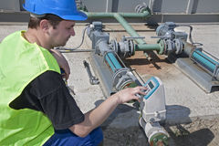 Man at work by touch panel. Industry Stock Image