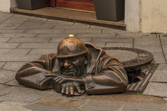 Man at Work. Whimsical sculpture in Bratislava, Slovakia Royalty Free Stock Image
