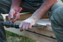 Man at work. A man working builds with a hammer and chisel Royalty Free Stock Images