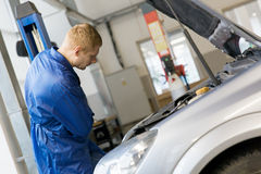 Man worker in auto service Royalty Free Stock Photo