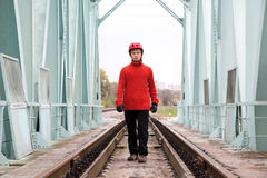 Man worker blindly in a helmet stands on the rails Royalty Free Stock Image