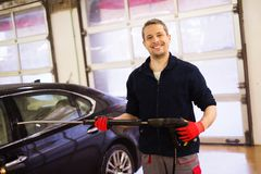 Man worker on a car wash Royalty Free Stock Photos