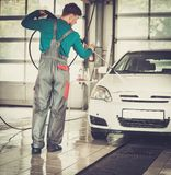 Man worker on a car wash Stock Images