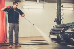Man worker on a car wash Royalty Free Stock Photography
