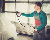 Man worker on a car wash Stock Photos