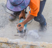 Man worker cutting concrete with Circular saw. Royalty Free Stock Photos