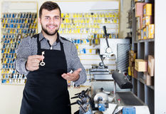 Man worker demonstrating result of key forming Stock Photography