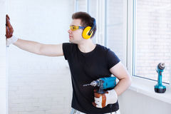 Man worker with drill Royalty Free Stock Image