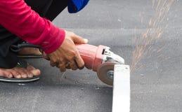 Man worker grinding steel. Stock Image