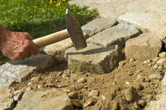 Man. Worker hand paving stones Royalty Free Stock Images