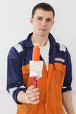 Man worker is holding paint brush Stock Images