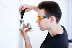 Man worker installing lamp Stock Image