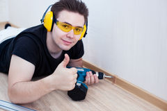 Man worker installing plinth. On balcony stock photos