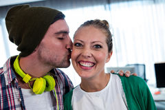 Man worker kissing his colleague Royalty Free Stock Photos