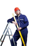 Man, worker on the ladder Royalty Free Stock Image