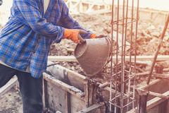 Man worker mixing cement mortar plaster for construction with vi Royalty Free Stock Images
