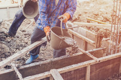Man worker mixing cement mortar plaster for construction with vi Royalty Free Stock Photos
