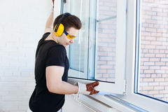 Man worker mounting window Stock Photography