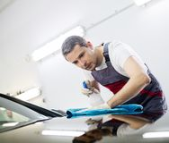 Free Man Worker On A Car Wash Royalty Free Stock Images - 48894019