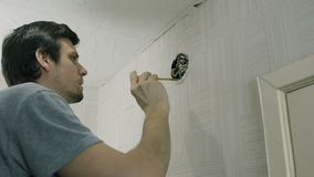 Man worker open the lid of electrical junction box and repairing the wires with screwdriver.  stock footage