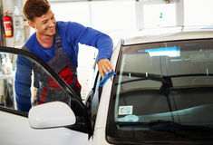 Man worker polishing car on a car wash Stock Image